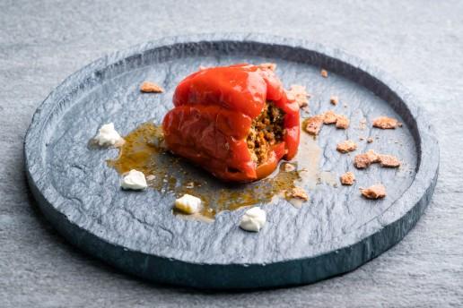 Food photography of a single stuffed paprika.